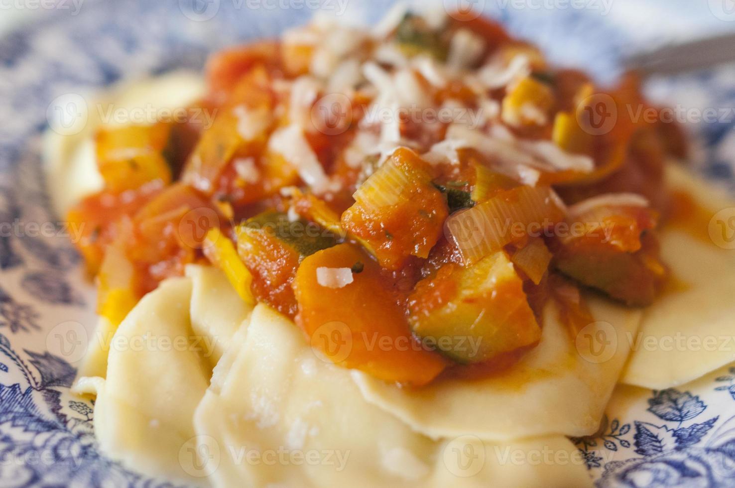 ravioli with vegetable sauce photo