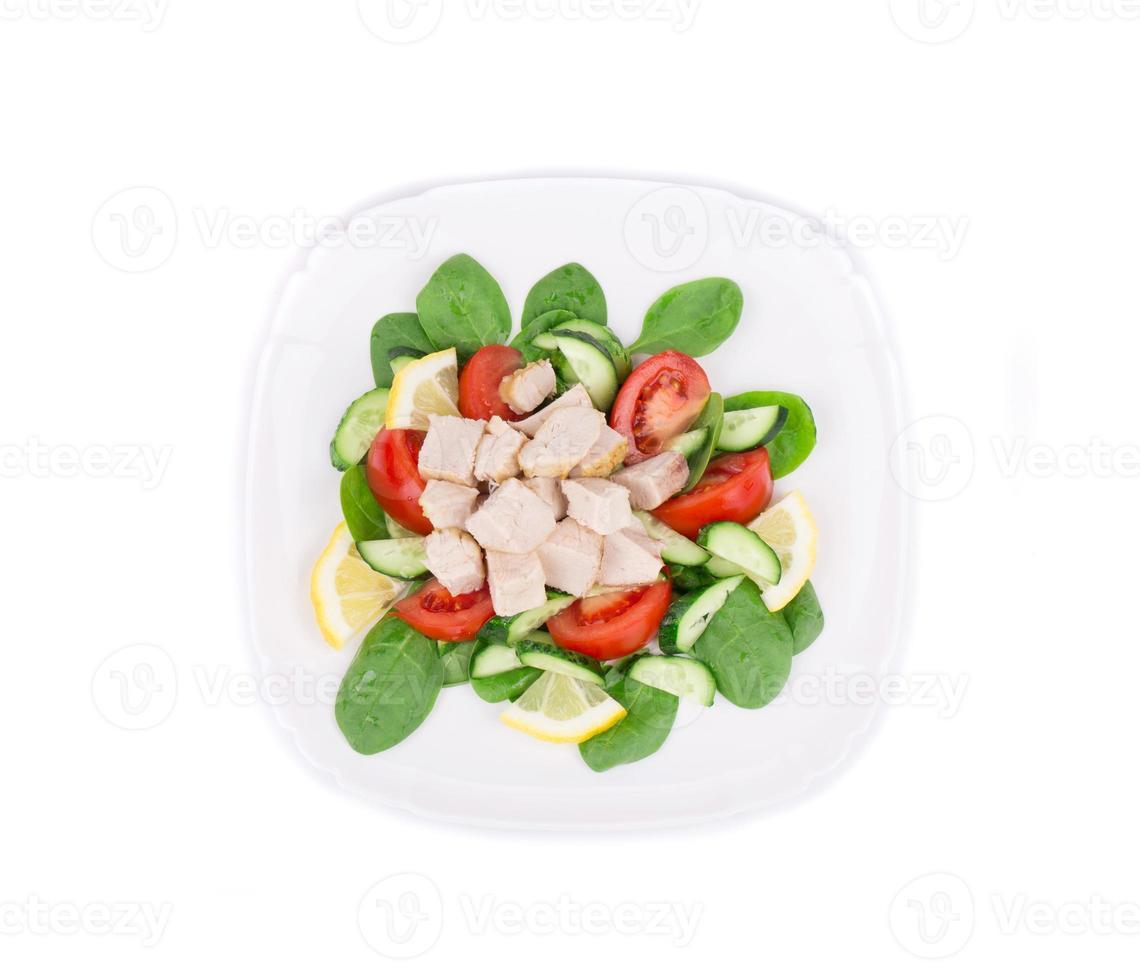 Chicken salad with tomatoes and spinach. photo