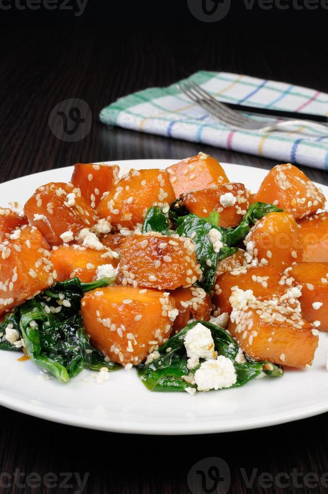 pumpkin with spinach and sesame seeds photo