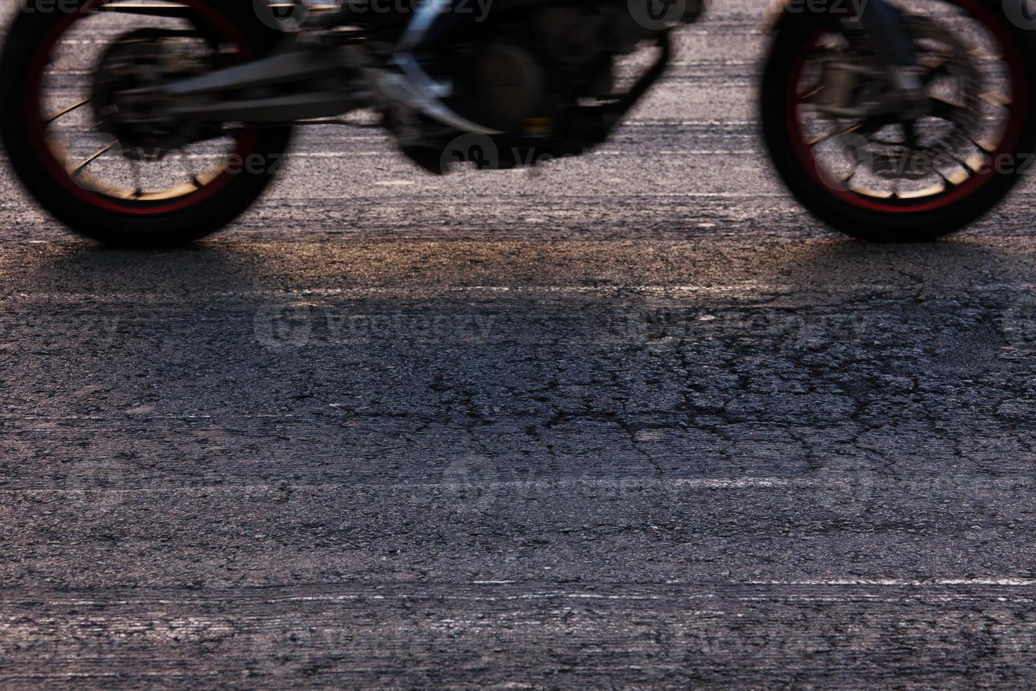 Rapidly riding a motorcycle on the road photo