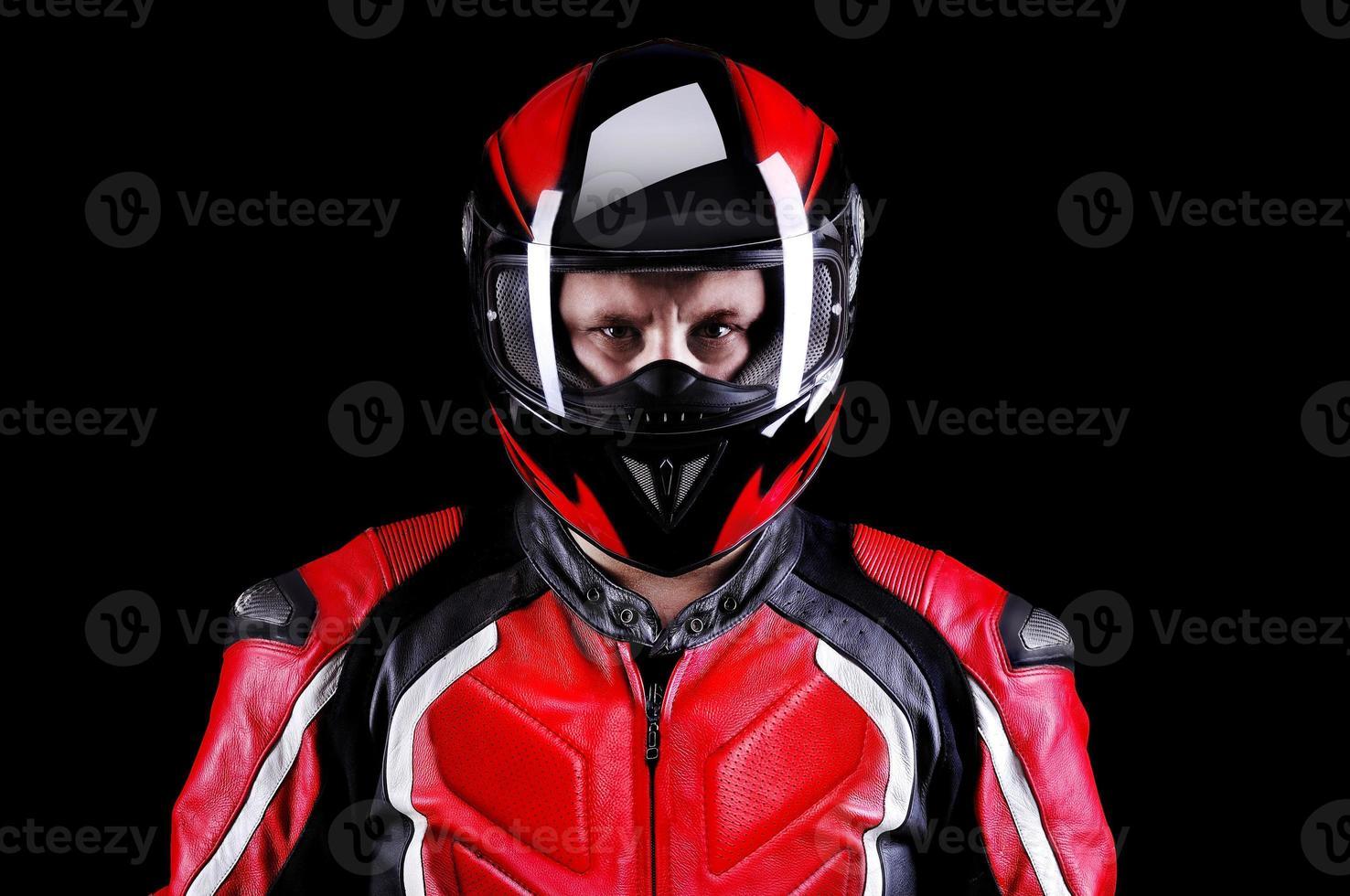 Biker in helmet on black background photo