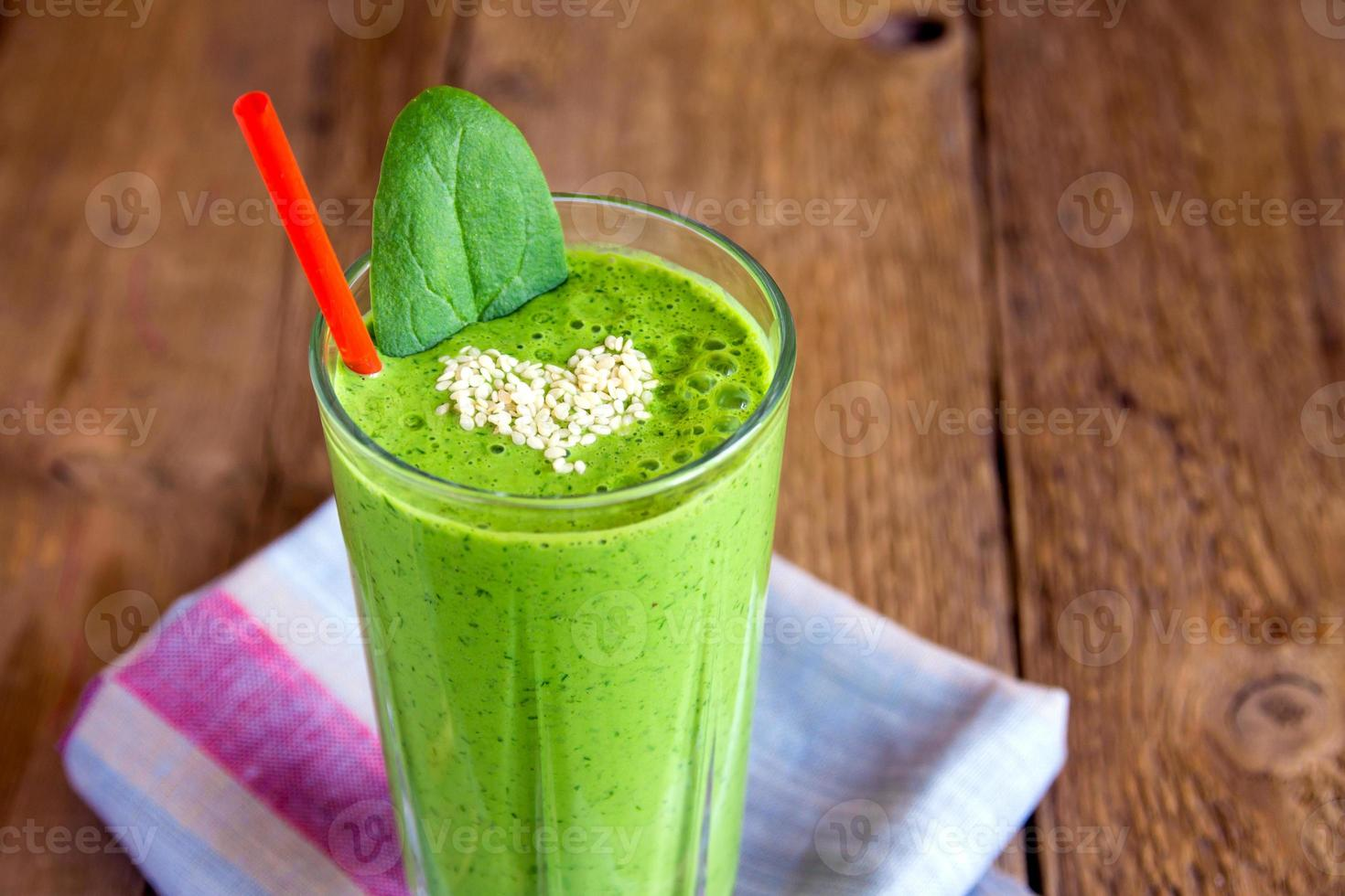 Green smoothie with heart of sesame seeds photo