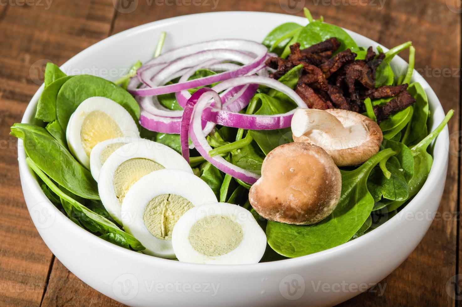 Bowl of egg and spinach salad photo