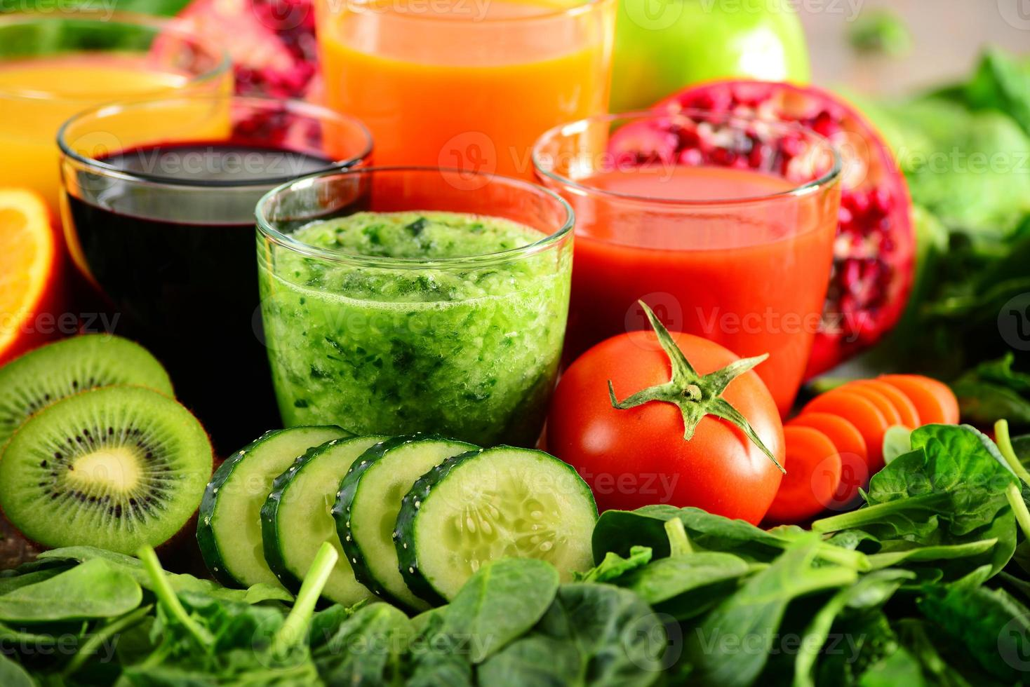 Glasses with fresh organic vegetable and fruit juices photo