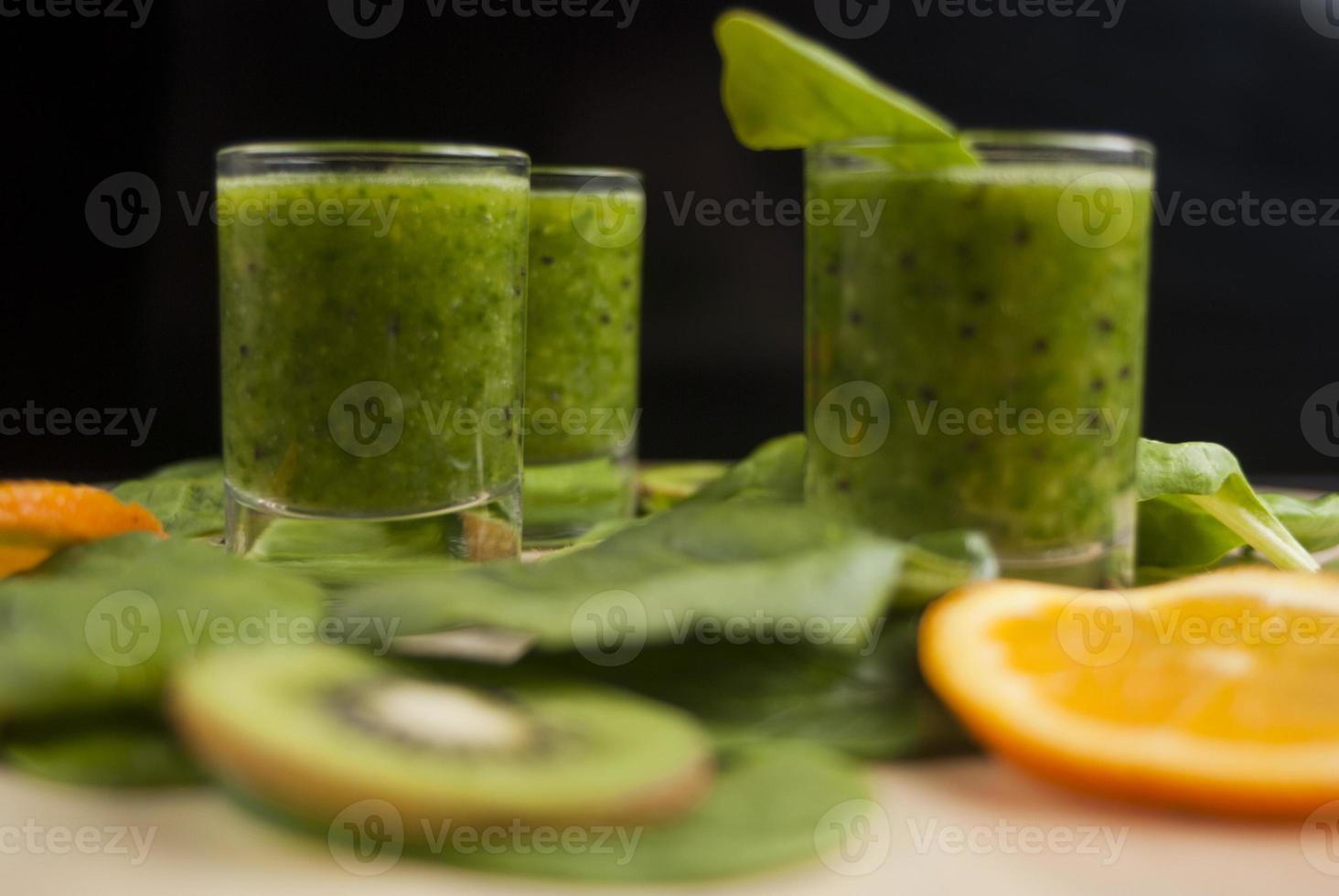 fresh green smoothie with spinach and kiwi photo