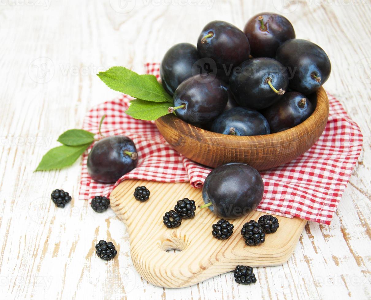 Fresh purple plums and blackberry photo