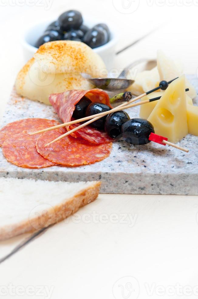 mix cold cut on a stone with fresh pears photo