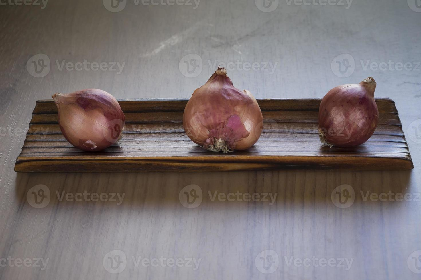 onions on a kitchen board photo