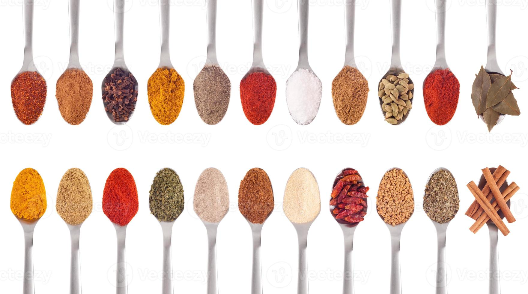 Spices collection on spoons photo