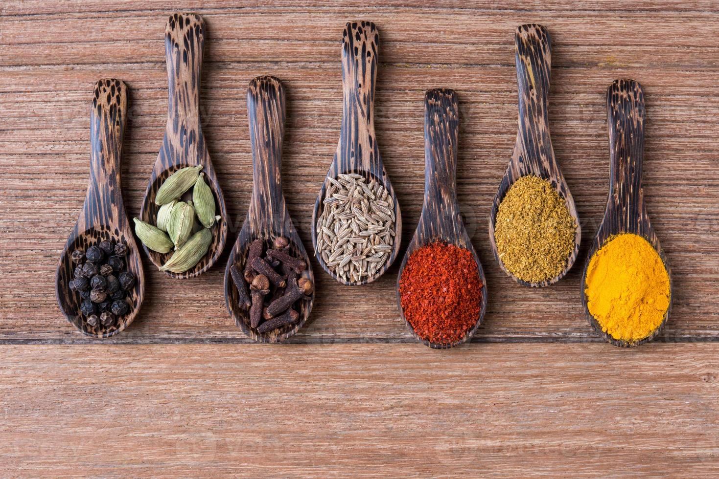 all spice powders and seed herbs photo
