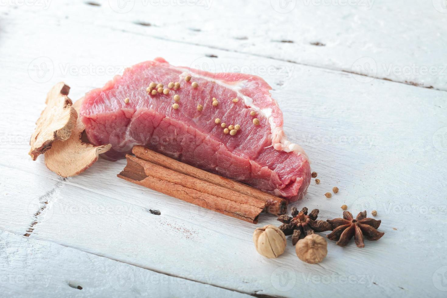 Raw meat decorated with herb photo