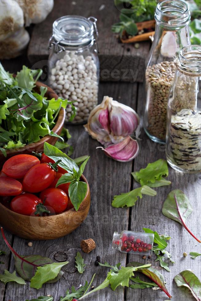 Tomatoes, salad leaves, beans and rice photo