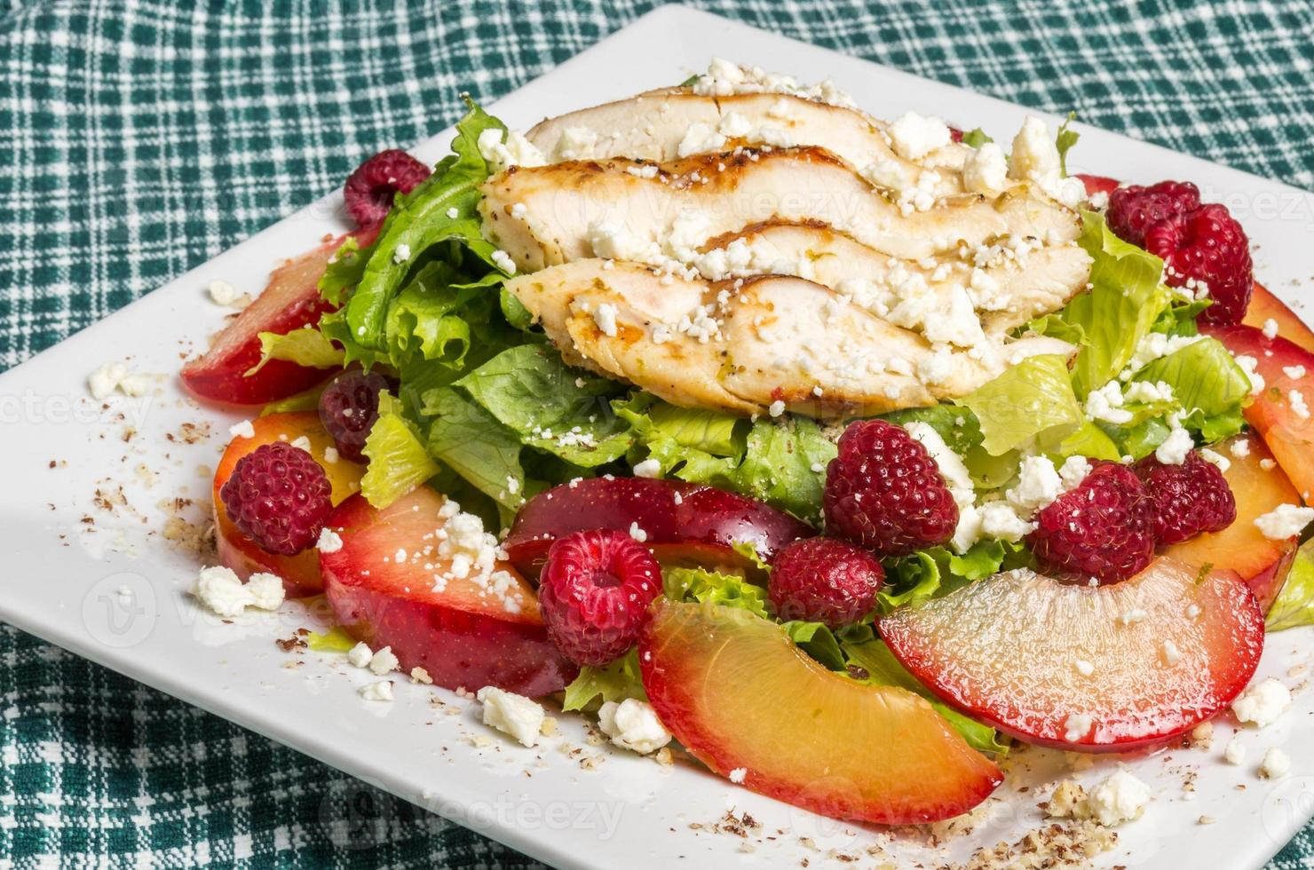 Chicken salad with plums and raspberries photo