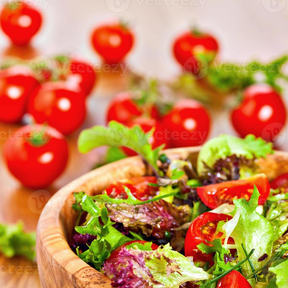 Mixed lettuce salad and tomatoes photo
