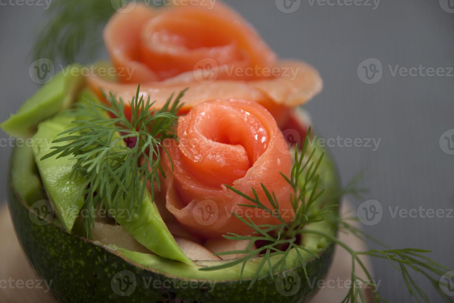 Salad with salmon in half avocado    . photo
