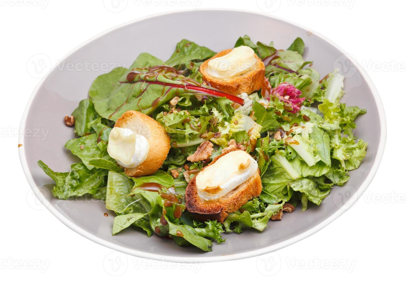 green salad with goat cheese and croutons photo