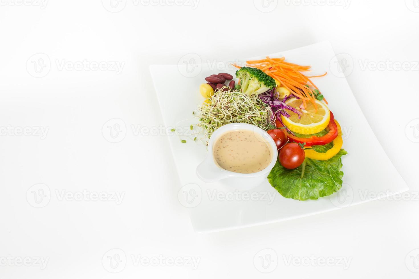 Delicious healthy salad on a dish. photo