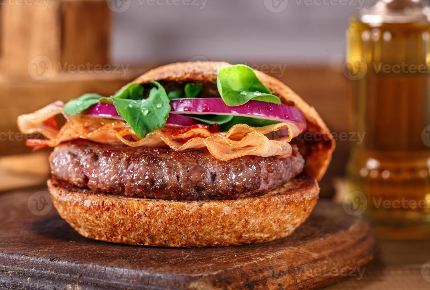 Burger close up on a cutting board on wooden background. photo
