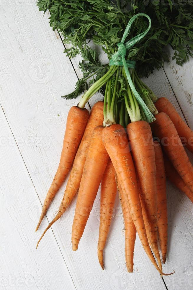 fresh carrots in tied bunch photo