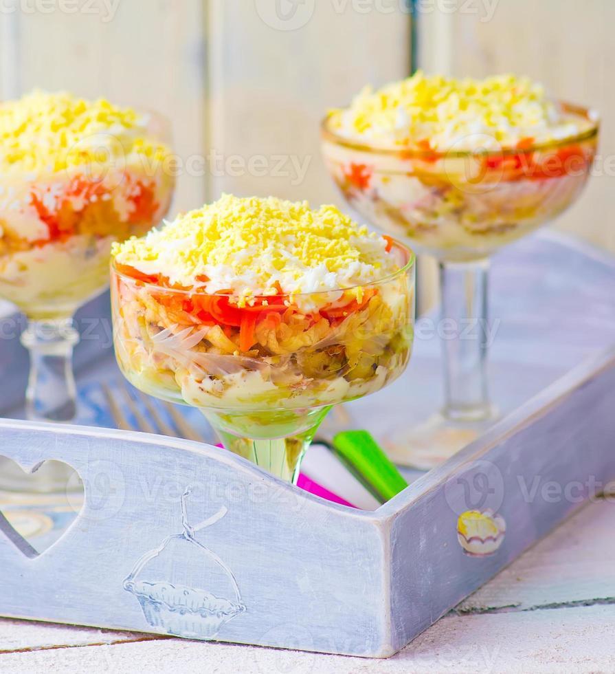traditional Russian salad Mimosa photo