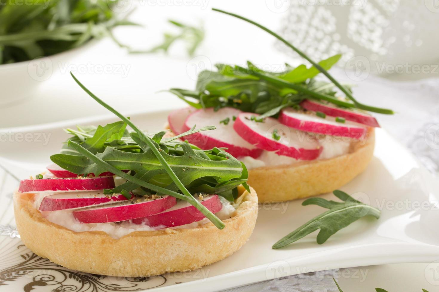 Tartlets salad with cheese and radish. photo