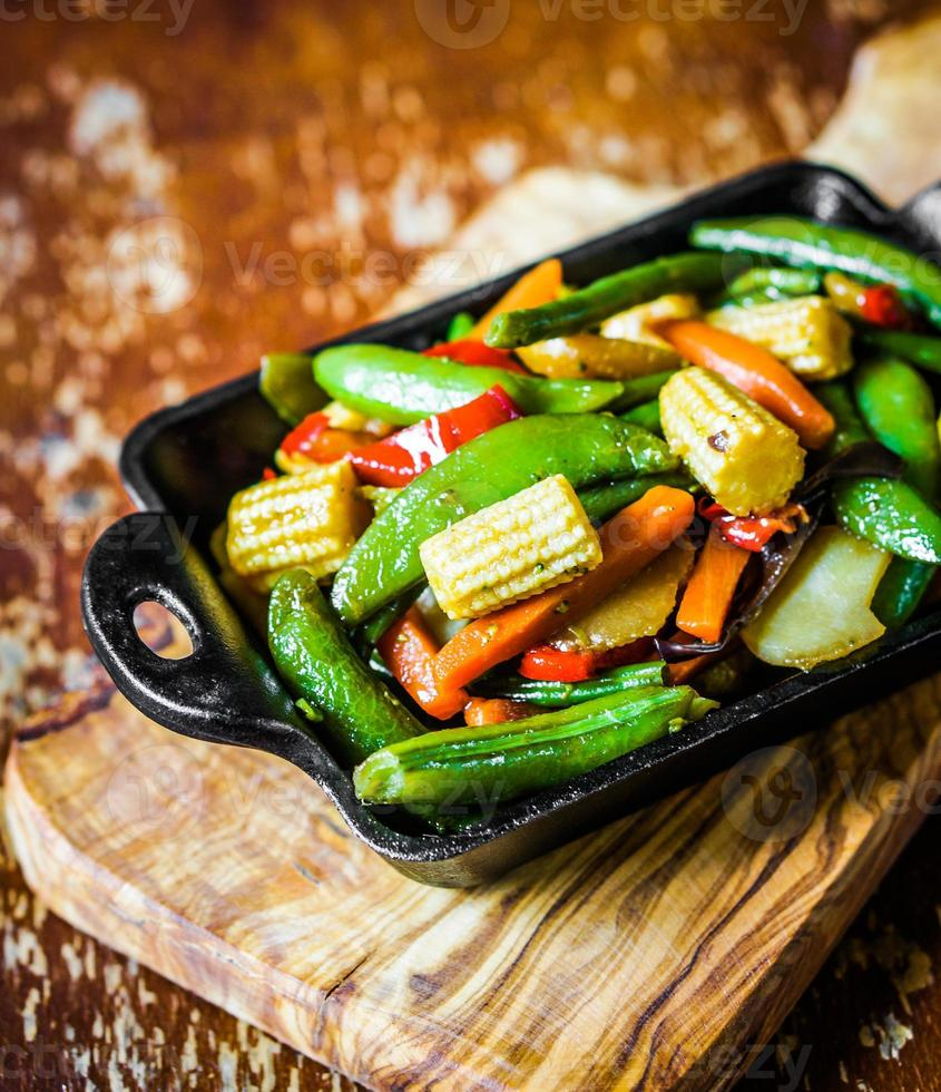 Baked vegetables on rustic background photo