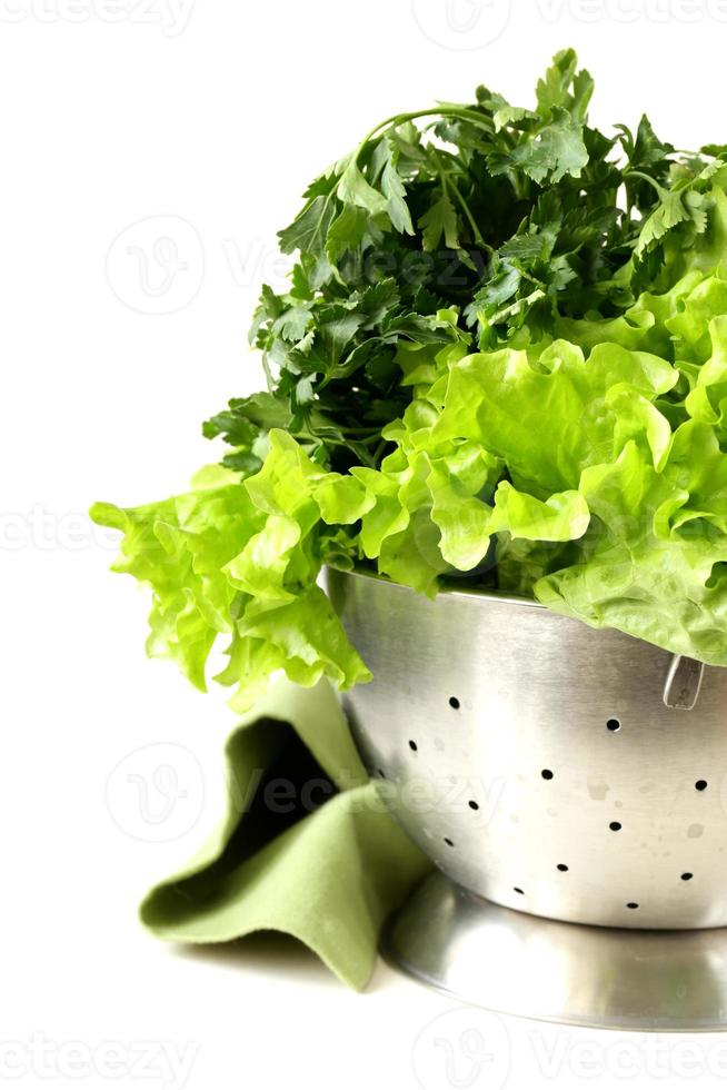 green lettuce and parsley in a metal colander photo