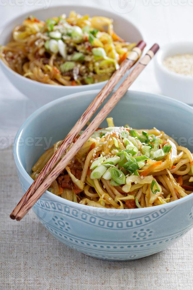 Stir fry with noodles, cabbage and carrot photo