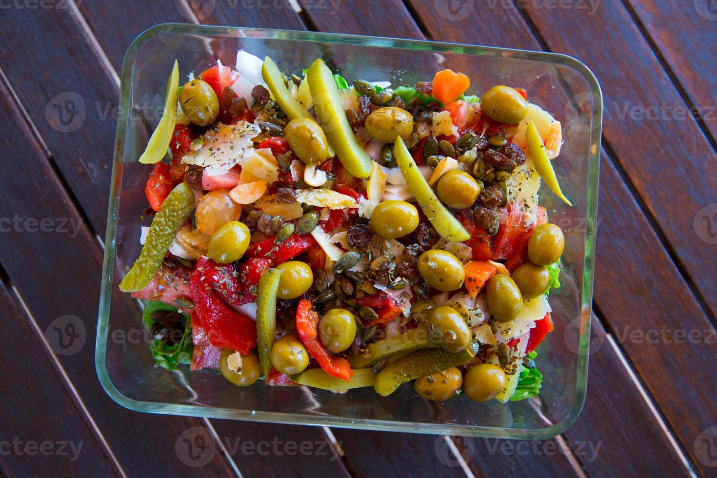 Mediterranean salad with tomato olives cucumber lettuce photo
