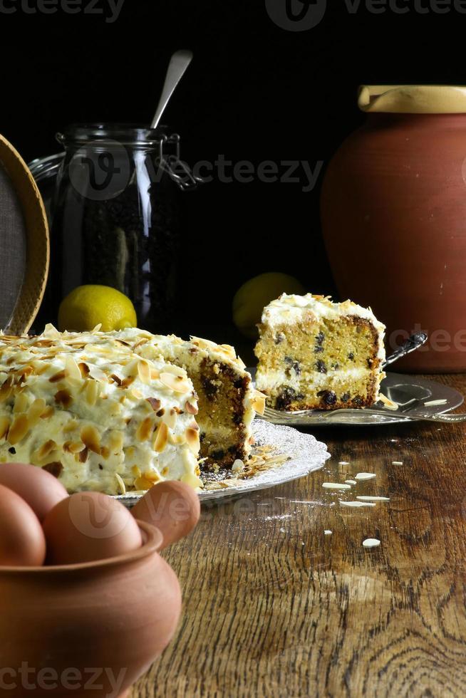 Homemade Carrot Cake and slice on Glass Plate Fresh Eggs photo