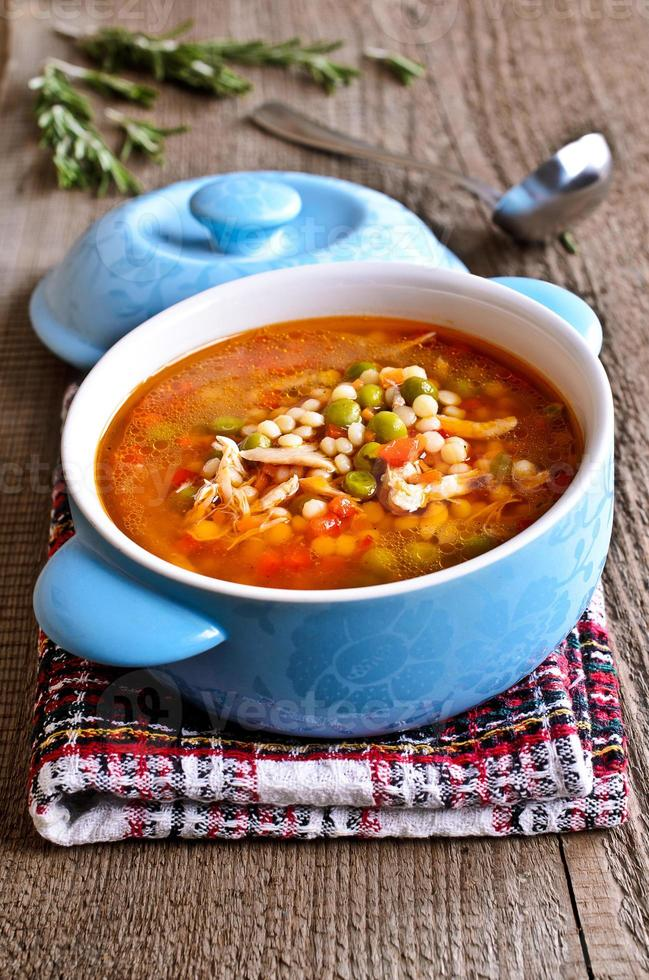Soup with small pasta, vegetables and pieces of meat photo