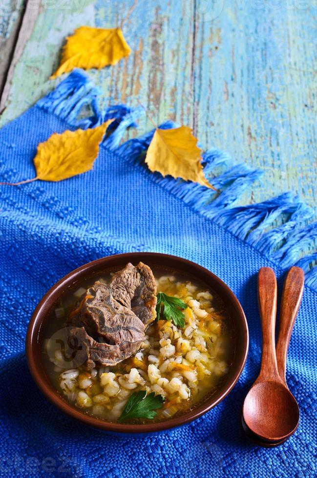 Soup with pearl barley and meat photo