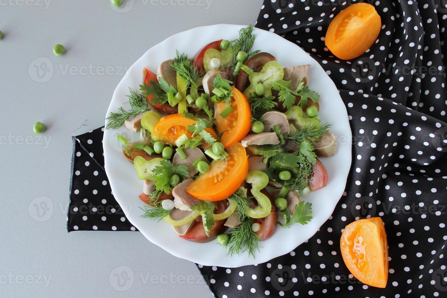 salad with lamb tongue, tomatoes, and balsamic vinegar photo