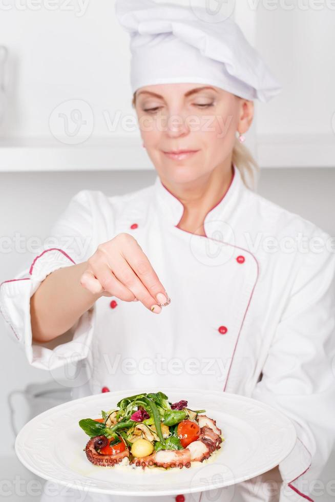 Chef-cook presenting meals photo