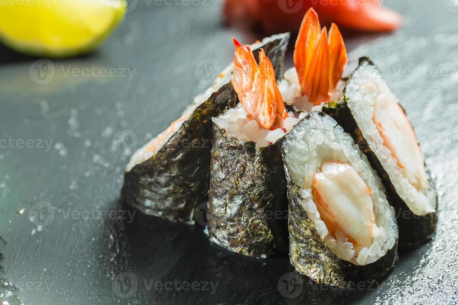 Rolls with shrimp on the black photo