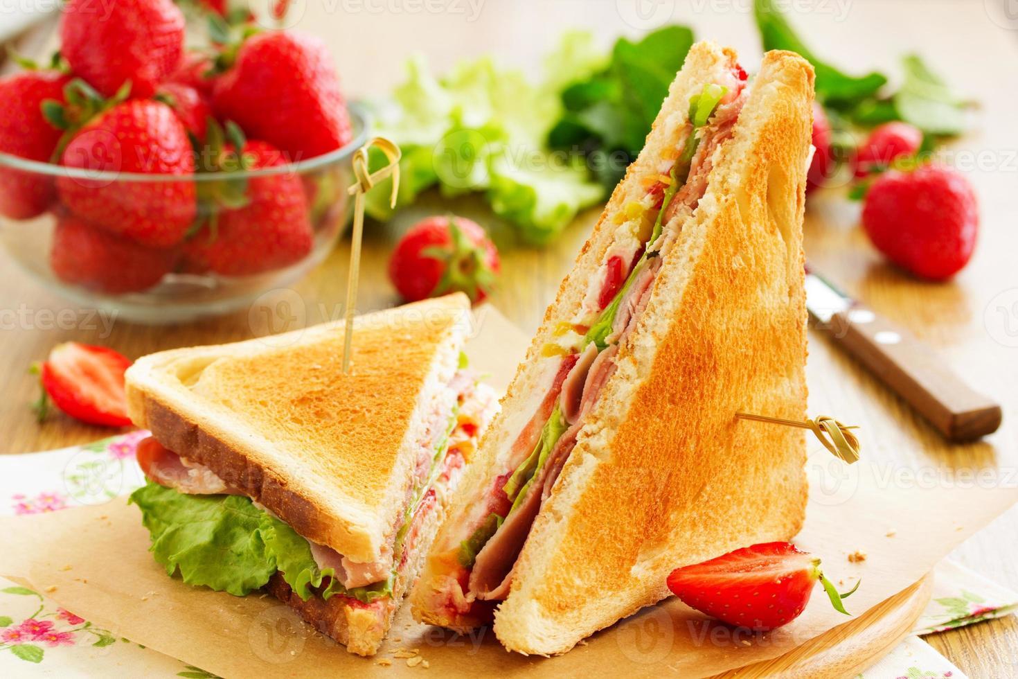 Dietary turkey sandwich and strawberry. photo