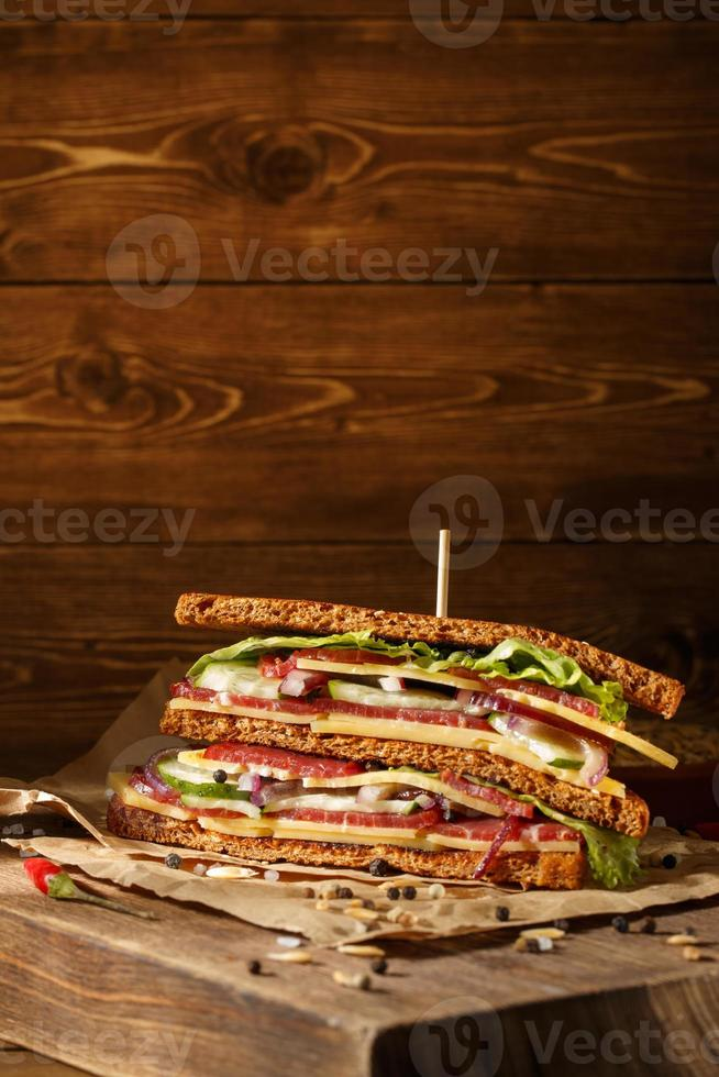 Sandwich on old papper with big cutting board photo