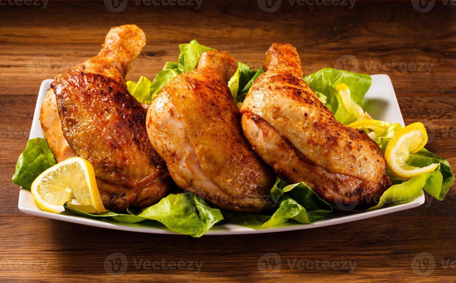 cosce di pollo arrosto foto