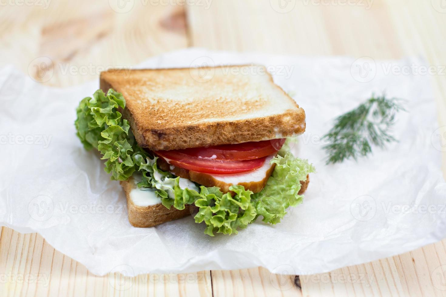 Healthy ham sandwich with cheese, tomatoes and lettuce photo
