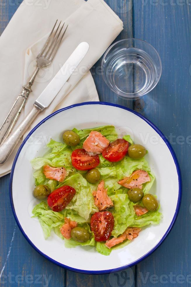 salad with fish on white plate photo