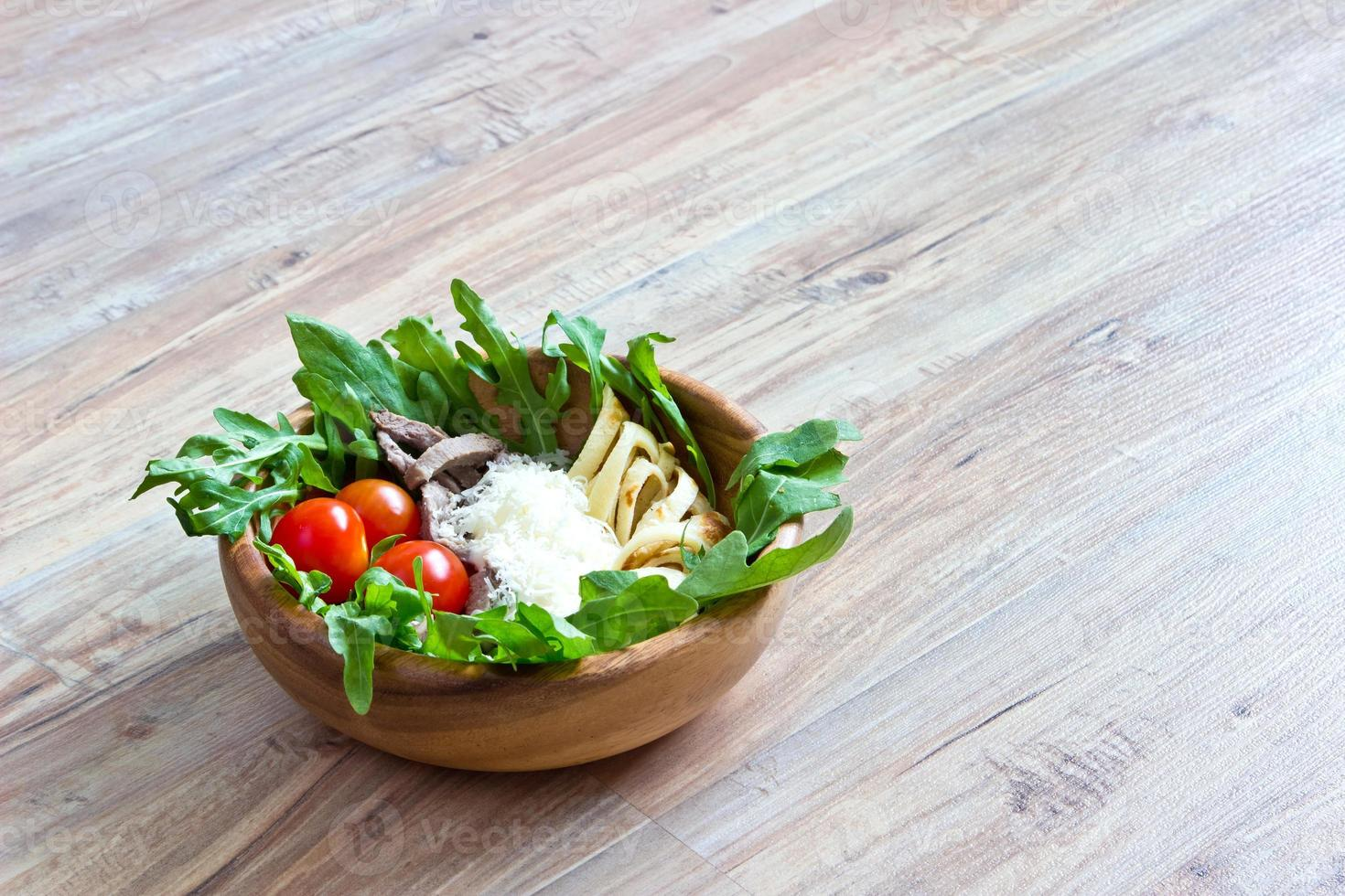Salad of beef tongue, lettuce, tomatoes, cheese, scrambled eggs photo
