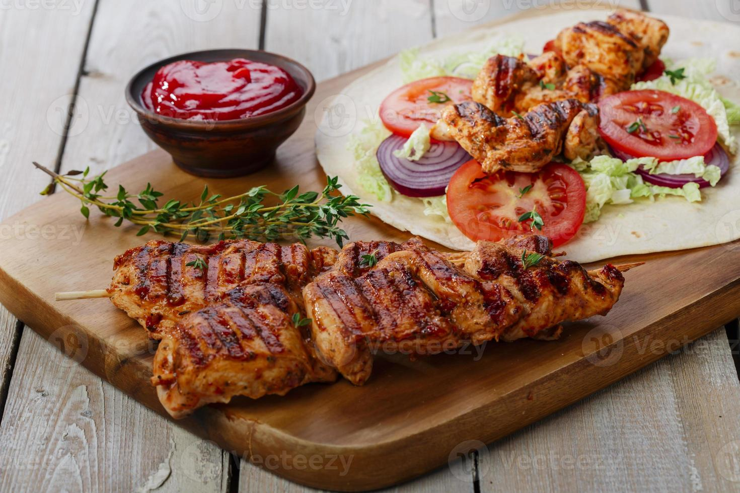 grilled chicken shawarma with sauce photo