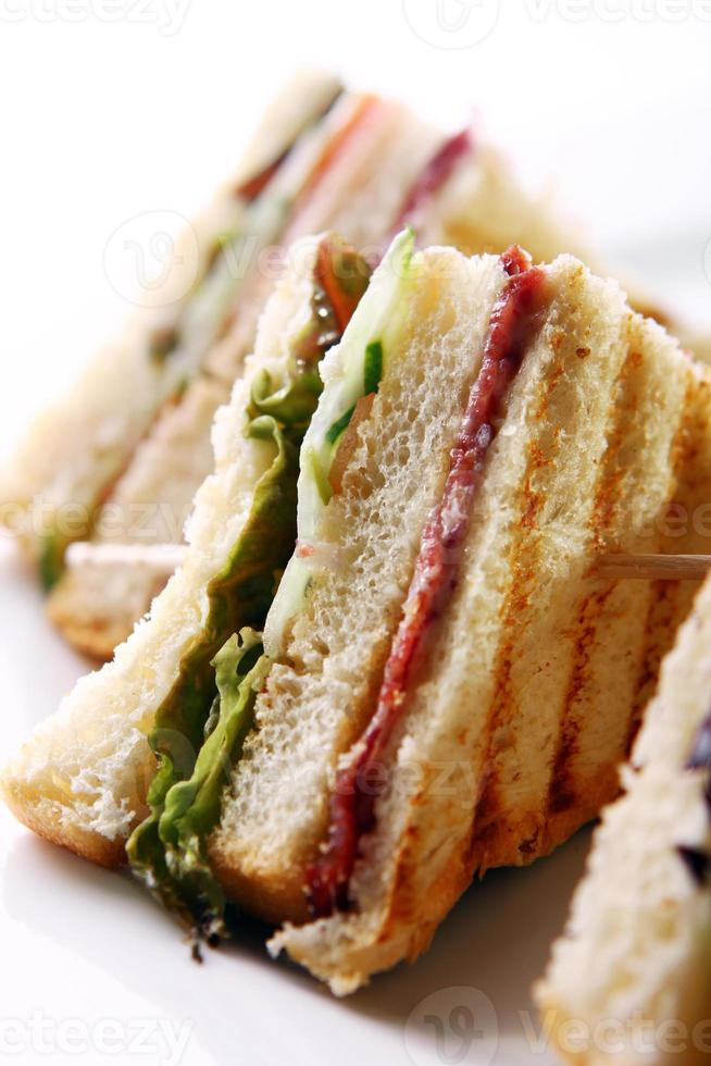 Club sandwich with meat and green photo