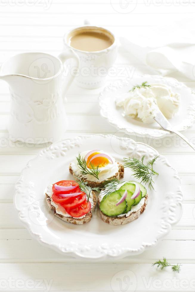 Appetizer sandwiches and cheese and vegetables. photo