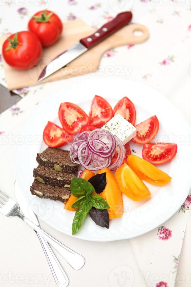 Red and yellow tomato salad photo