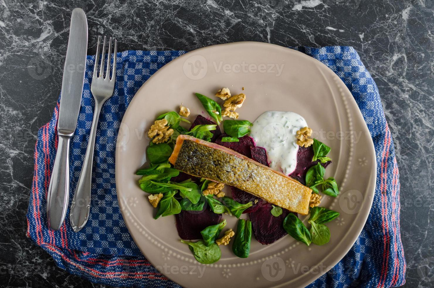 Fried salmon with herbs and beets photo
