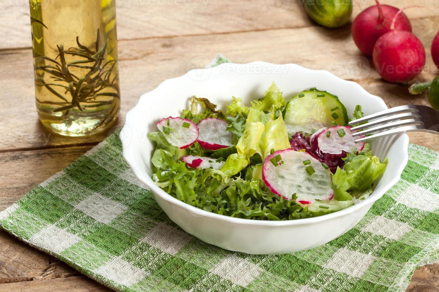 Salad with radish and green cucumber photo