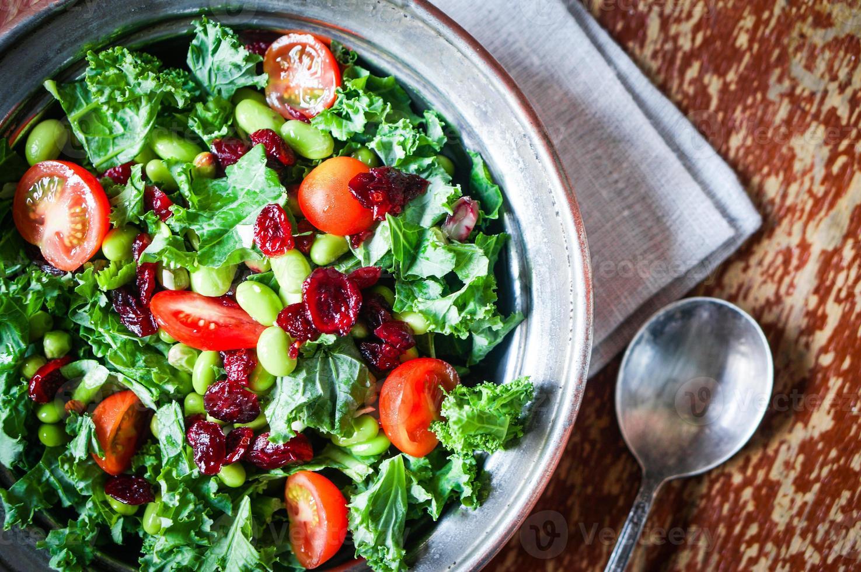 Kale and edamame salad on rustic background photo