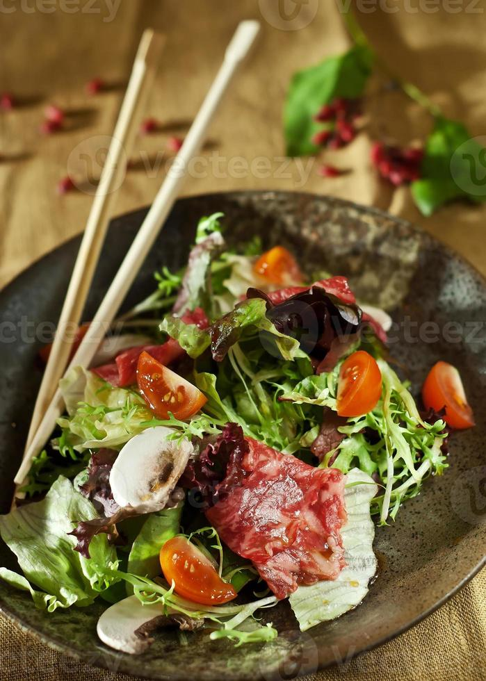 Warm salad with cutting of a marbled beef photo
