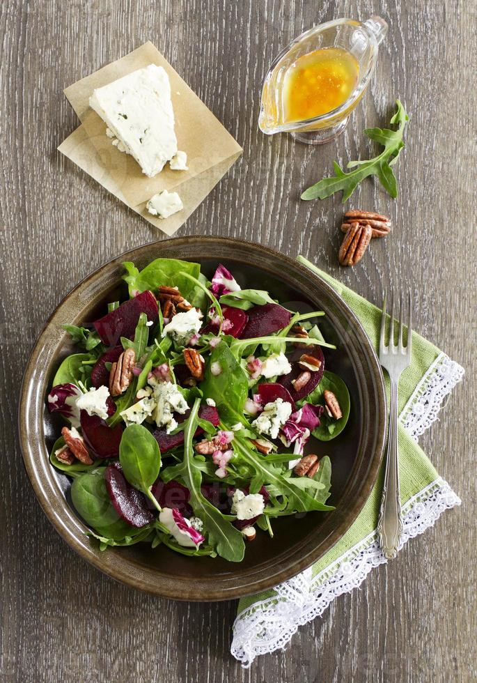 Salad with beet, blue cheese, nuts and vinaigrette. photo